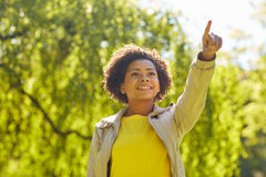 Happy african american young woman in summer park Royalty Free Stock Images