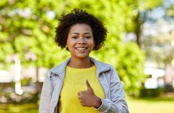 Happy african american young woman in summer park Royalty Free Stock Photography