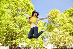Happy african american young woman in summer park Stock Photos