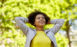 Happy african american young woman in summer park Stock Photography