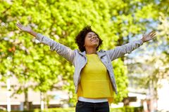 Happy african american young woman in summer park Royalty Free Stock Photo
