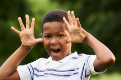 Happy african boy making a grimace at camera Royalty Free Stock Photo
