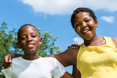 Happy african brother and sister outdoors. stock images