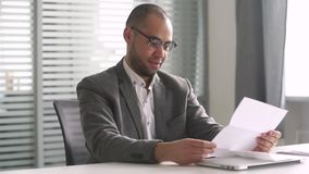 Happy african businessman read mail letter excited by good news. Happy african american businessman winner open envelope read mail letter excited by good news stock footage