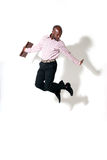 Happy african businessman smiling. With briefcase jumping with shadow Royalty Free Stock Photo
