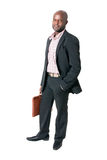 Happy african businessman smiling. With briefcase isolated Stock Image