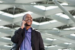 Happy african businessman talking on mobile phone Stock Photos