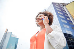 Happy african businesswoman calling on smartphone Royalty Free Stock Photography