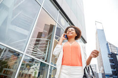 Happy african businesswoman calling on smartphone Royalty Free Stock Images