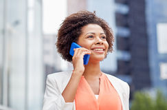 Happy african businesswoman calling on smartphone Stock Photos