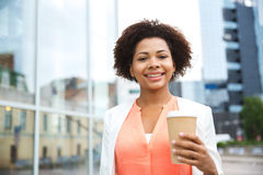 Happy african businesswoman with coffee in city Royalty Free Stock Photo