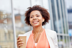 Happy african businesswoman with coffee in city Stock Image