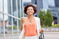 Happy african businesswoman with coffee in city Royalty Free Stock Photos