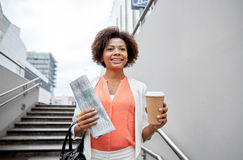 Happy african businesswoman with coffee in city Stock Images