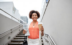 Happy african businesswoman with coffee in city Royalty Free Stock Image