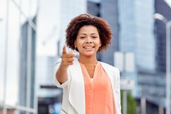 Happy african businesswoman pointing finger on you Royalty Free Stock Image