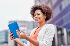 Happy african businesswoman with tablet pc in city Royalty Free Stock Image