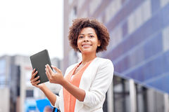 Happy african businesswoman with tablet pc in city Stock Photography