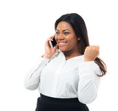 Happy african businesswoman talking on the phone Royalty Free Stock Photos