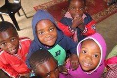 Happy african children looking into the camera in rural Swaziland, Africa. African children playing in a small preschool in Swaziland Royalty Free Stock Photos