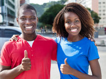 Happy african couple showing thumbs up Royalty Free Stock Photography
