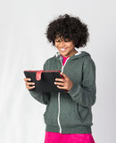 Happy African Decent Child with a tablet Royalty Free Stock Image