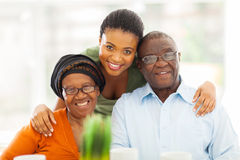 Happy african family. Portrait of happy african family at home royalty free stock image