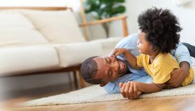 Free Happy African Father And Little Child Son Spending Time Playing At Home Together Stock Photography - 176557402