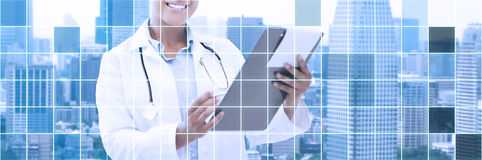 Happy african female doctor with clipboard Royalty Free Stock Photo