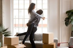 Happy african first time home buyers couple celebrating moving d royalty free stock photography