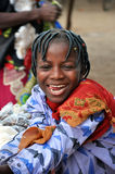 Happy African girl. Burkina Faso, Africa, A happy African girl with a beautiful smile and traditional clothes Royalty Free Stock Image