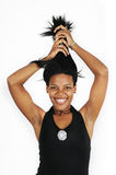 Happy african girl holding her hair stock image