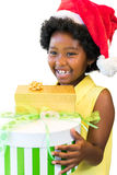 Happy african girl holding presents. royalty free stock photo