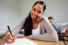 Happy african girl in school Stock Photography