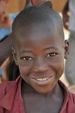 Happy African young boy. Burkina Faso, Africa. A happy African children is smiling looking the camera Stock Photography