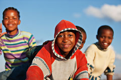 Happy African kids. Group of African children with happy faces against the sky Royalty Free Stock Image