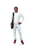 Happy african man with bag standing Stock Photos