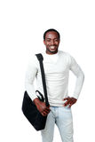 Happy african man with bag standing Stock Photo