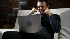 Happy African Man Celebrating Success of Work on Laptop. 4k , high quality stock video footage