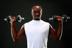 Happy african man with dumbbells Royalty Free Stock Photos
