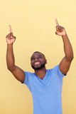 Happy african man with fingers pointing up Stock Image