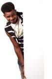 Happy African man holding empty bill board stock photo