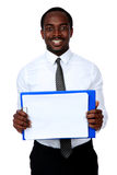 Happy african man holding folder. And showing blank document Stock Photo