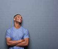 Happy african man laughing with arms crossed Stock Photography