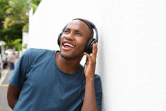 Happy african man listening to music on headphones Royalty Free Stock Photos