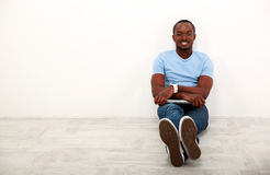 Happy african man sitting with laptop Stock Photography