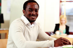 Happy african man sitting at the table Royalty Free Stock Photography