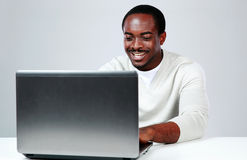 Happy african man sitting at the table Royalty Free Stock Photos