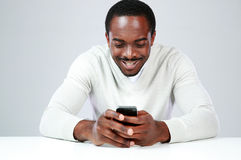 Happy african man sitting at the table Royalty Free Stock Image