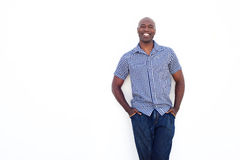 Happy african man standing against white background. Portrait of happy african man standing against white background Royalty Free Stock Photos